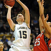 Legacy's Carli Moreland goes to the basket against Denver East's Deidra Smith during the class 5A championship game at the Coors Events Center in Boulder on Friday.<br /> <br /> <br /> March 10, 2010<br /> Staff photo/David R. Jennings