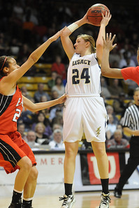 Legacy's Quincey Noonan shoots  to the basket against Denver East's Samantha Sanders during the class 5A championship game at the Coors Events Center in Boulder on Friday.   March 10, 2010 Staff photo/David R. Jennings