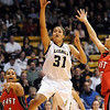 Legacy's Sade Akindele goes to the basket against Denver East during the class 5A championship game at the Coors Events Center in Boulder on Friday.<br /> <br /> <br /> March 10, 2010<br /> Staff photo/David R. Jennings