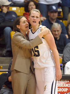 Legacy's Carli Moreland hugs head coach Jamie Carey after fouling out and loosing to Denver East 46 to 50 in the class 5A championship game at the Coors Events Center in Boulder on Friday.   March 10, 2010 Staff photo/David R. Jennings