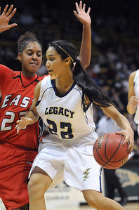Legacy's Kailey Edwards drives to the basket against Denver East's Shae Kelley during the class 5A championship game at the Coors Events Center in Boulder on Friday.   March 10, 2010 Staff photo/David R. Jennings