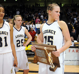 Legacy's Carli Moreland holds the second place trophy after the loss to Denver East in the class 5A championship game at the Coors Events Center in Boulder on Friday.   March 10, 2010 Staff photo/David R. Jennings