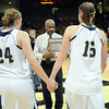 Legacy's Quincey Noonan and Carli Moreland hold hands as they walk to accept the second place trophy after the loss to Denver East'in the class 5A championship game at the Coors Events Center in Boulder on Friday.<br /> <br /> <br /> March 10, 2010<br /> Staff photo/David R. Jennings
