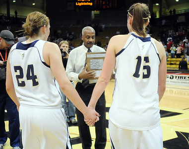Legacy's Quincey Noonan and Carli Moreland hold hands as they walk to accept the second place trophy after the loss to Denver East'in the class 5A championship game at the Coors Events Center in Boulder on Friday.   March 10, 2010 Staff photo/David R. Jennings