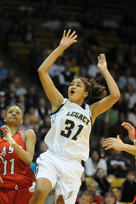 Legacy's Sade Akindele watches the ball go to the basket against Denver East's Raven Taylor during the class 5A championship game at the Coors Events Center in Boulder on Friday.   March 10, 2010 Staff photo/David R. Jennings