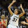 Legacy's Sade Akindele watches the ball go to the basket against Denver East's Raven Taylor during the class 5A championship game at the Coors Events Center in Boulder on Friday.<br /> <br /> <br /> March 10, 2010<br /> Staff photo/David R. Jennings