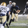 Jake Levin, Legacy, runs the ball downfield through Mullen's line during Friday's game at North Stadium.<br /> <br /> November 13, 2009<br /> Staff photo/David R. Jennings