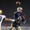 Legacy's quarterback Bradie Koch passes the ball past Mullen's Beau Martin during Friday's game at North Stadium.<br /> <br /> November 13, 2009<br /> Staff photo/David R. Jennings