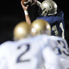Legacy's Jake Levin catches a pass ahead of Mullen's Cole Gilmore and Dylon Storm during Friday's game at North Stadium.<br /> <br /> November 13, 2009<br /> Staff photo/David R. Jennings