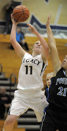 "Legacy's Emily Glen goes to the basket against Poudre's Myanne Hamm during Thursday's game at Legacy. <br /> For more photos please see  <a href=""http://www.broomfieldenterprise.com"">http://www.broomfieldenterprise.com</a><br /> January 26, 2012<br /> staff photo/ David R. Jennings"