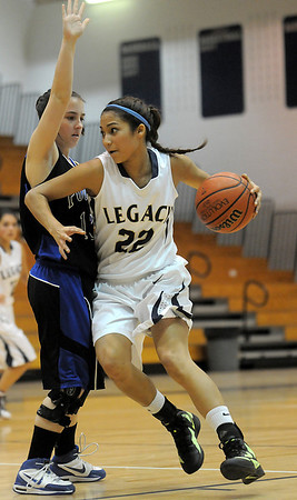 "Legacy's Kailey Edwards dribbles the ball around Poudre's Kerry Niccoli during Thursday's game at Legacy. <br /> For more photos please see  <a href=""http://www.broomfieldenterprise.com"">http://www.broomfieldenterprise.com</a><br /> January 26, 2012<br /> staff photo/ David R. Jennings"