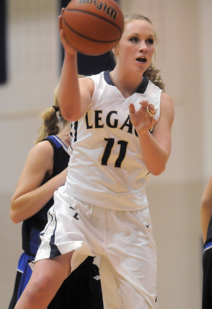 "Legacy's Emily Glen passes the ball past Poudre during Thursday's game at <br /> Legacy. <br /> For more photos please see  <a href=""http://www.broomfieldenterprise.com"">http://www.broomfieldenterprise.com</a><br /> January 26, 2012<br /> staff photo/ David R. Jennings"