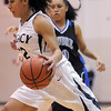 "Legacy's Mackenzie Neely drives the ball past Poudre's Tiara Baca-Burrell during Thursday's game at <br /> Legacy. <br /> For more photos please see  <a href=""http://www.broomfieldenterprise.com"">http://www.broomfieldenterprise.com</a><br /> January 26, 2012<br /> staff photo/ David R. Jennings"