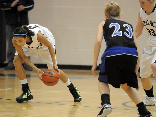 "Legacy's Kailey Edwards scoops up a loose ball from Poudre during Thursday's game at Legacy. <br /> For more photos please see  <a href=""http://www.broomfieldenterprise.com"">http://www.broomfieldenterprise.com</a><br /> January 26, 2012<br /> staff photo/ David R. Jennings"