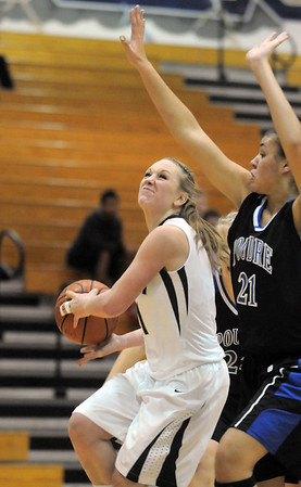"Legacy's Emily Glen heads to the basket against Poudre's Myanne Hamm during Thursday's game at Legacy. <br /> For more photos please see  <a href=""http://www.broomfieldenterprise.com"">http://www.broomfieldenterprise.com</a><br /> January 26, 2012<br /> staff photo/ David R. Jennings"