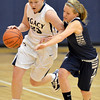 Legacy's Caitlyn Smith dribbles the ball past Air Academy's Carly Wilborn  during Thursday's game at Legacy.<br /> <br /> December 13, 2012<br /> staff photo/ David R. Jennings
