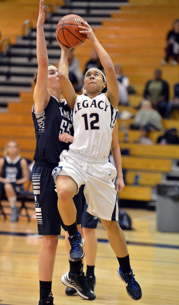 Legacy's Mackenzie Neely goes to the basket against Air Academy's Kassadey Huffman  during Thursday's game at Legacy.<br /> <br /> December 13, 2012<br /> staff photo/ David R. Jennings