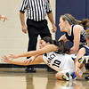 Legacy's Emiley Lopez reaches for a loose ball against  Air Academy's Kassadey Huffman and Justine Jenkinson during Thursday's game at Legacy.<br /> <br /> December 13, 2012<br /> staff photo/ David R. Jennings