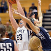 Legacy's Caitlyn Smith rebounds the ball against  Air Academy's Avery Downey  during Thursday's game at Legacy.<br /> <br /> December 13, 2012<br /> staff photo/ David R. Jennings