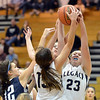 Legacy's Caitlyn Smith, right, rebounds the ball against   Air Academy's Avery Downey  during Thursday's game at Legacy.<br /> <br /> December 13, 2012<br /> staff photo/ David R. Jennings