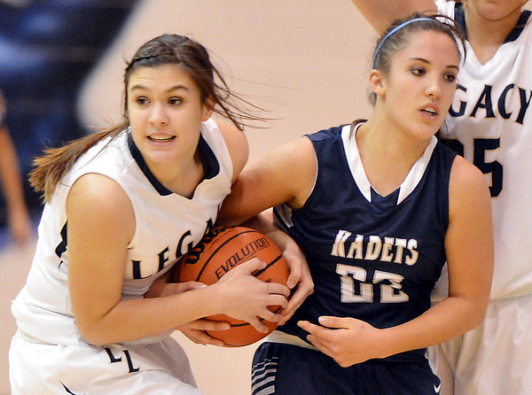 Legacy's Jenna Fenton fights for control of the ball with  Air Academy's Hayley Rhein  during Thursday's game at Legacy.<br /> <br /> December 13, 2012<br /> staff photo/ David R. Jennings