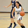 Legacy's Emiley Lopez dribbles the ball down court against  Air Academy's during Thursday's game at Legacy.<br /> <br /> December 13, 2012<br /> staff photo/ David R. Jennings