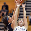 Legacy's Jennifer Aicega tries to rebound the ball against Air Academy's Avery Downey  during Thursday's game at Legacy.<br /> <br /> December 13, 2012<br /> staff photo/ David R. Jennings