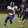 Boulder's Demetrius Kennedy runs the ball downfield against Legacy during Thursday's game at Five Star Stadium in Thornton.<br /> October 18, 2012<br /> staff photo/ David R. Jennings