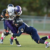Boulder's Demetrius Kennedy, after catching a pass, is tackled by Legacy's Jake Bublitz during Thursday's game at Five Star Stadium in Thornton.<br /> October 18, 2012<br /> staff photo/ David R. Jennings
