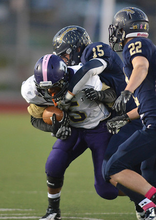 Boulder's Demetrius Kennedy is tackled by Legacy's Jake Bublitz during Thursday's game at Five Star Stadium in Thornton.<br /> October 18, 2012<br /> staff photo/ David R. Jennings