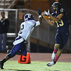 Legacy's Mitch McCall tries to catch a pass past Boulder's Luis Escobar during Thursday's game at Five Star Stadium in Thornton.<br /> October 18, 2012<br /> staff photo/ David R. Jennings