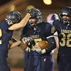 Legacy's Jake Bublitz, center, celebrates with teammates after intercepting a pass by Boulder during Thursday's game at Five Star Stadium in Thornton.<br /> October 18, 2012<br /> staff photo/ David R. Jennings