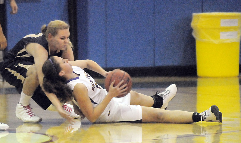 "Boulder's Courtney Van Bussum fights for contorl of the ball with Legacy's Courtney Smith during Thursday's game at Centaurus for the Boulder Valley Invitational tournament .<br /> <br /> For more photos please go to  <a href=""http://www.broomfieldenterprise.com"">http://www.broomfieldenterprise.com</a>.<br /> <br /> December 8, 2011<br /> Staff photo/ David R. Jennings"