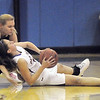 """Boulder's Courtney Van Bussum fights for contorl of the ball with Legacy's Courtney Smith during Thursday's game at Centaurus for the Boulder Valley Invitational tournament .<br /> <br /> For more photos please go to  <a href=""""http://www.broomfieldenterprise.com"""">http://www.broomfieldenterprise.com</a>.<br /> <br /> December 8, 2011<br /> Staff photo/ David R. Jennings"""