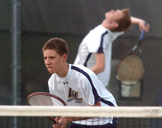 Legacy High's #1 doubles team of Eli VanZandt, front, stands by as Tyler Archibald, serves against Brighton High's #1 doubles team of Levi White and Taylor Chikuma during play at Legacy on Tuesday.<br /> <br /> Sept. 1, 2009<br /> staff photo/David R. Jennings