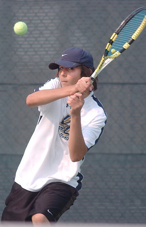 Luca Pomerleau, Legacy High #1 singles, returns the ball during the match against Jonathan Evangelista, Brighton #1 singles, on Tuesday  at Legacy.<br /> <br /> Sept. 1, 2009<br /> staff photo/David R. Jennings