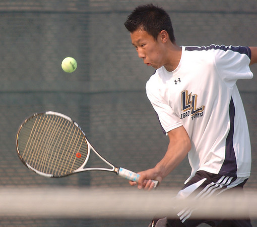 Alex Ho, Legacy #2 singles, returns the ball back to Brighton's #2 singles player David Evangelista during the match at Legacy on Tuesday.<br /> <br /> Sept. 1, 2009<br /> staff photo/David R. Jennings
