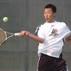 Alex Ho, Legacy #2 singles, hits the ball to Brighton's #2 singles player David Evangelista during the match at Legacy on Tuesday.<br /> <br /> Sept. 1, 2009<br /> staff photo/David R. Jennings