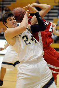Legacy's Brett Gioia fights for the ball with Brighton's Chris Douglass during Wednesday's game at Legacy. January 27, 2010 Staff photo/David R. Jennings
