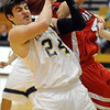 Legacy's Brett Gioia fights for the ball with Brighton's Chris Douglass during Wednesday's game at Legacy.<br /> January 27, 2010<br /> Staff photo/David R. Jennings