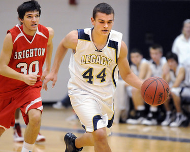 Legacy's Bob May drives the ball down court away from Brighton's Danny Martinez during Wednesday's game at Legacy. January 27, 2010 Staff photo/David R. Jennings