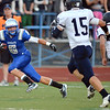 The Eagle's Gian Panicucci runs with the ball while being pursued by the Lightning's Jake Bublitz and Nick Weaver during the Broomfield vs. Legacy football game at Elizabeth Kennedy Stadium on Friday.<br /> September 7, 2012<br /> staff photo/ David R. Jennings