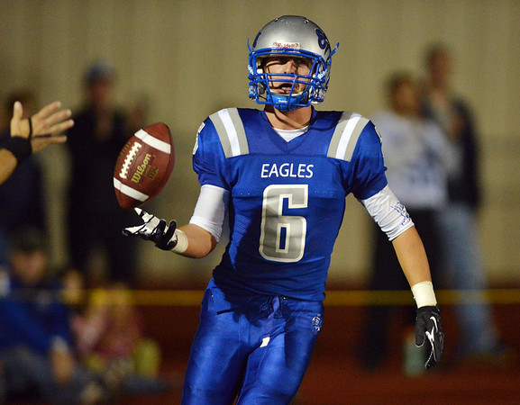 Broomfield's Gian Panicucci hands the ball to the umpire after making a touchdown against Legacy during the Broomfield vs. Legacy football game at Elizabeth Kennedy Stadium on Friday.<br /> September 7, 2012<br /> staff photo/ David R. Jennings
