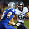 Legacy's Patrick Mathews carries the ball downfield against Broomfield's Gian Panicucci during the Broomfield vs. Legacy football game at Elizabeth Kennedy Stadium on Friday.<br /> September 7, 2012<br /> staff photo/ David R. Jennings