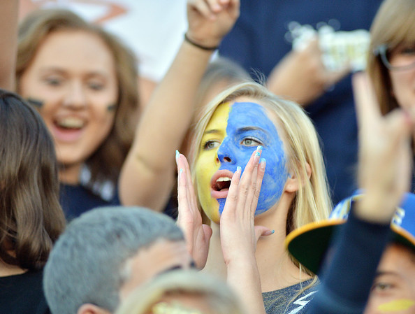 Legacy senior Rose McPherson cheers  during the Broomfield vs. Legacy football game at Elizabeth Kennedy Stadium on Friday.<br /> September 7, 2012<br /> staff photo/ David R. Jennings