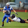 Broomfied's Ryan McCulley runs downfield as Legacy's  Nick Weaver attempts a tackle during the Broomfield vs. Legacy football game at Elizabeth Kennedy Stadium on Friday.<br /> September 7, 2012<br /> staff photo/ David R. Jennings