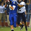 Broomfield's Gian Panicucci catches a pass while Legacy's Hunter Rainwater makes the tackle during the Broomfield vs. Legacy football game at Elizabeth Kennedy Stadium on Friday.<br /> September 7, 2012<br /> staff photo/ David R. Jennings