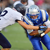 After catching a pass Broomfield's Gian Panicucci is tackled by Legacy's Hunter Rainwater during the Broomfield vs. Legacy football game at Elizabeth Kennedy Stadium on Friday.<br /> September 7, 2012<br /> staff photo/ David R. Jennings