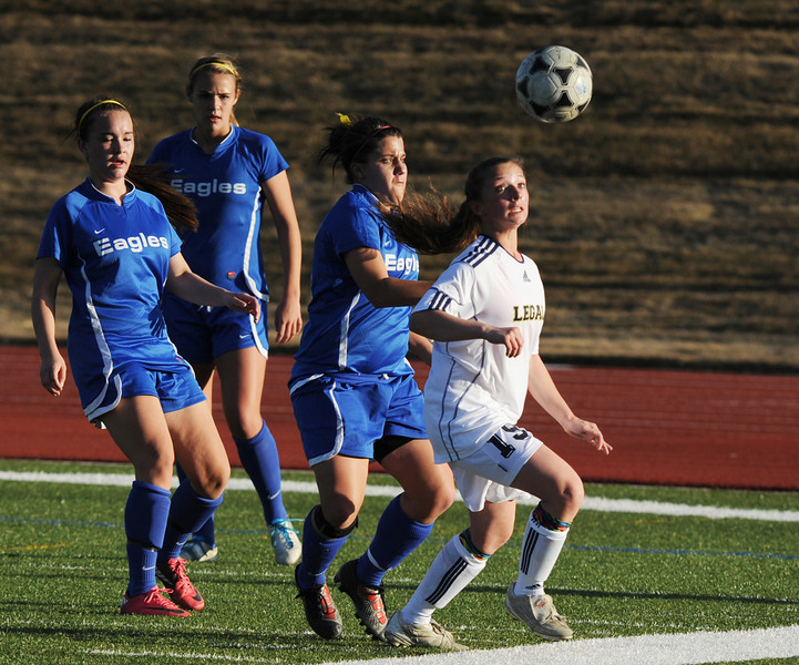 Legacy's Mady Huber advances the ball against Broomfield's Kerri Marquardt during Thursday's game at North Stadium.<br /> <br /> March 15,  2012 <br /> staff photo/ David R. Jennings