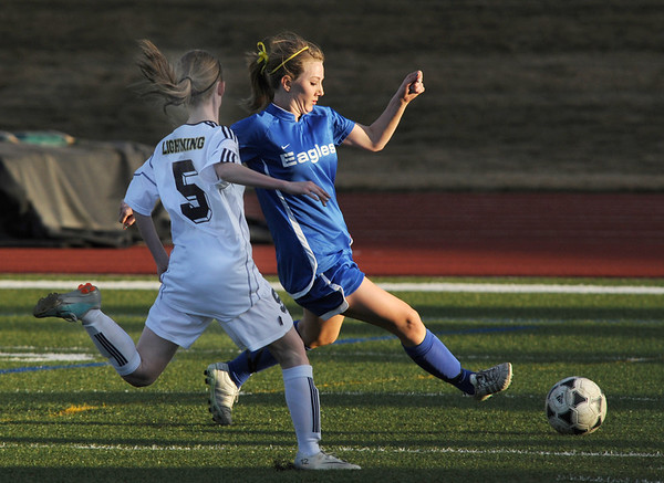Broomfield's Katie Forsee goes after the ball past Legacy's Eva Tucker during Thursday's game at North Stadium.<br /> <br /> March 15,  2012 <br /> staff photo/ David R. Jennings